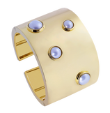 Yellow gold and pearls cuff